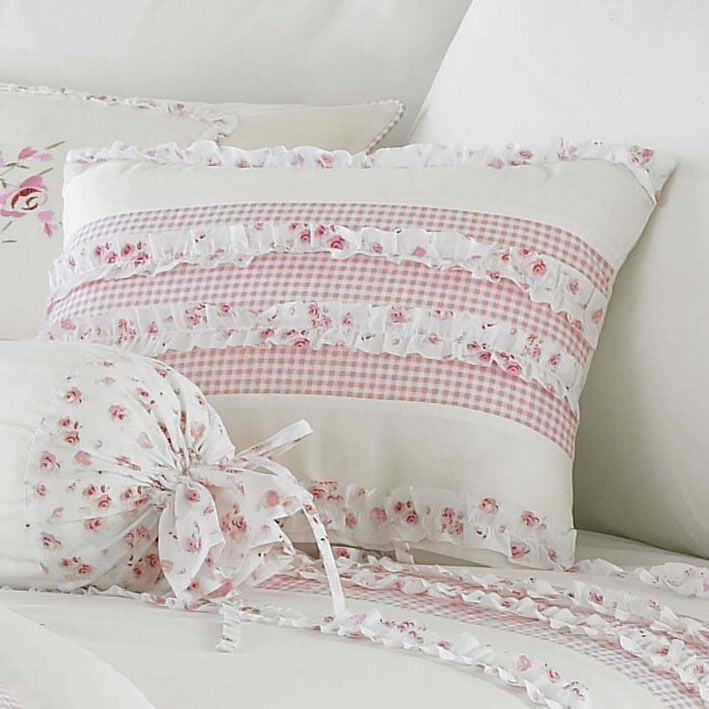 Gingham and floral cushion.  http://www.worldstores.co.uk/p/Riva_Home_Vintage_Cushion_in_Pink.htm