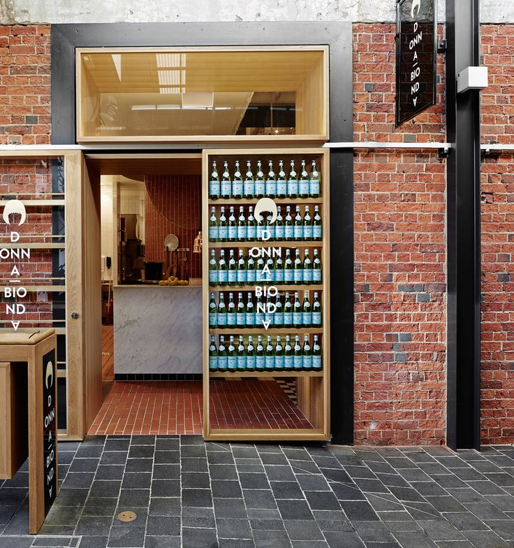 Donna Bionda by Richards & Spence | Yellowtrace. Red brick, timber, black metal shopfront