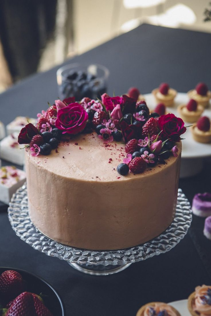 simple chocolate cake with berries and fresh flowers.