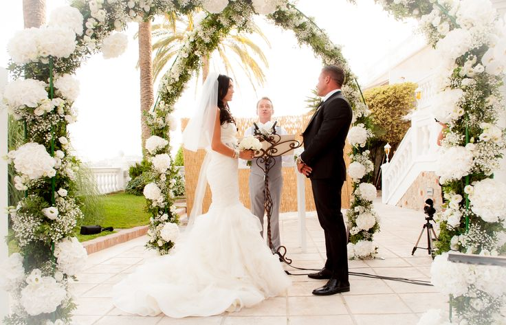The happy couple, complete with Vera Wang dress under the pergola  Photograph by Thomas Barr