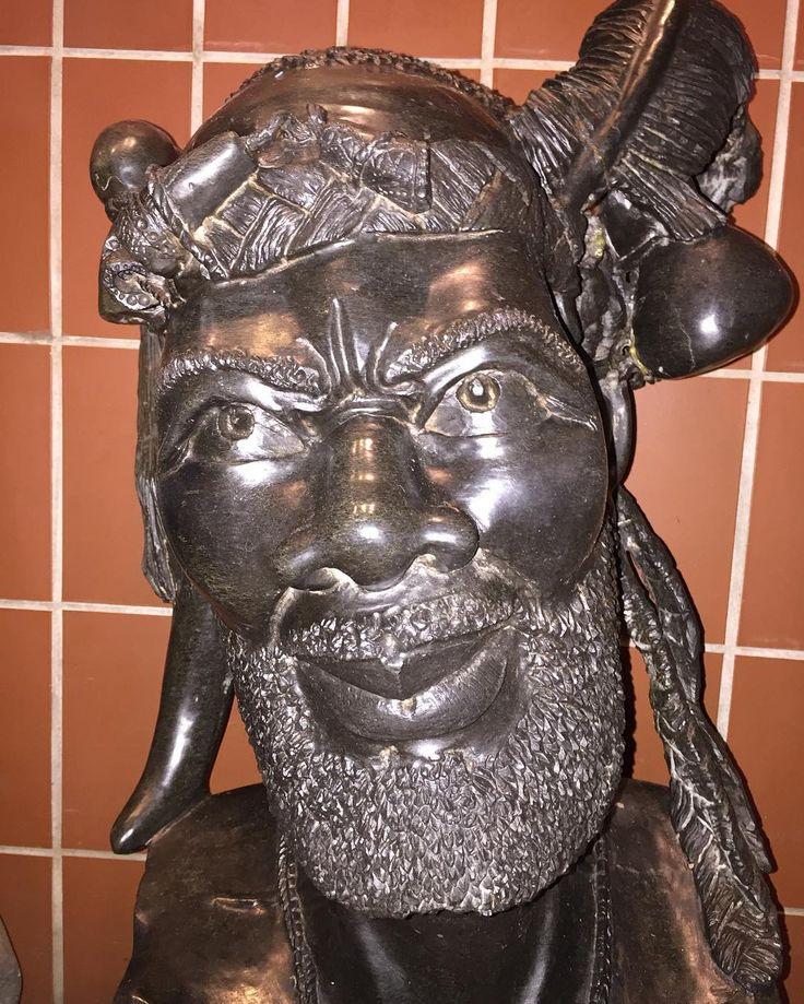 Stone bust of an older bearded man art sculpture