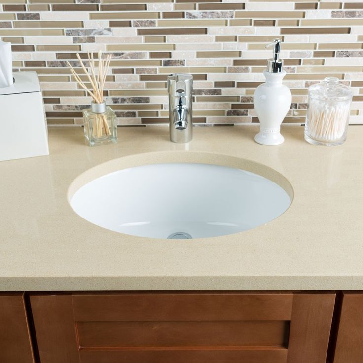 This Hahn sink is composed of beautiful white ceramic and porcelain. The smooth oval piece has an undermount style and is 6.5 inches deep to add a gentle elegance to the bathroom. 6.5 inches deep Buil
