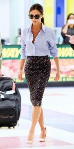 Business outfit, man's light blue shirt with pencil skirt and beige pumps by Victoria Beckham.