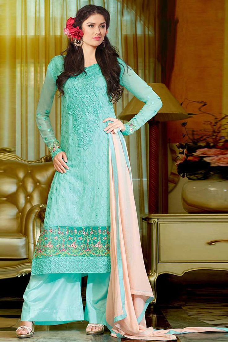 sky blue Georgette Trouser Suit with Chiffon Dupatta Price:-£49.00 Sky blue, Georgette, semi stictch trouser suit. Allover embroidered with embroidered, resham, zari and stone work.Boat neck , Below knee length , full sleeves kameez.Sky blue, santoon trouser.Light pink, chiffon dupatta with lace border with work.It is perfect for casual wear, festival wear and party wear wear. http://www.andaazfashion.co.uk/sky-blue-georgette-trouser-suits-dmv13475.html