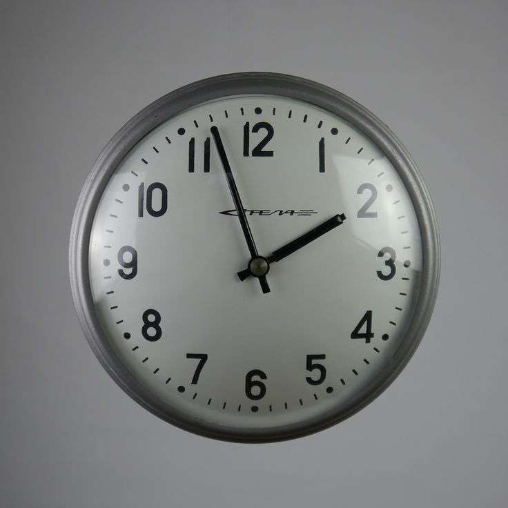 Russian factory clock, dating from the 1970's, with original silver/grey hammer-finish painted rims, white faces, black hands and numerals. Originally designed for mains power, these clocks have been modified and now comprise a standard, modern AA battery-driven mechanism.