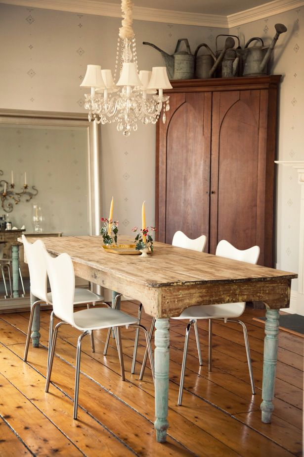 gorgeous rustic primitive harvest table with painted teal aqua legs. Don't love the chandelier, but the modern chairs with that table....ah.mazing.