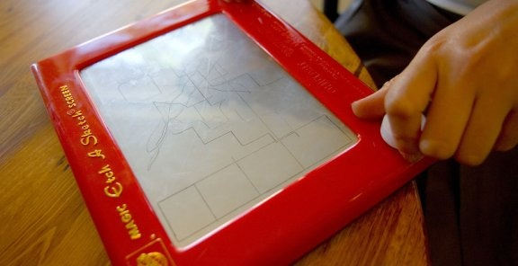 """Etch-a-Sketch:Invented by a French inventor, """"L'Ecran Magique"""" or """"Magic Screen"""" was what it was originally called. However, manufactured in Ohio, this iconic toy was introduced into the American market during the baby boom in the 60s after being purchased from a German toy fair."""