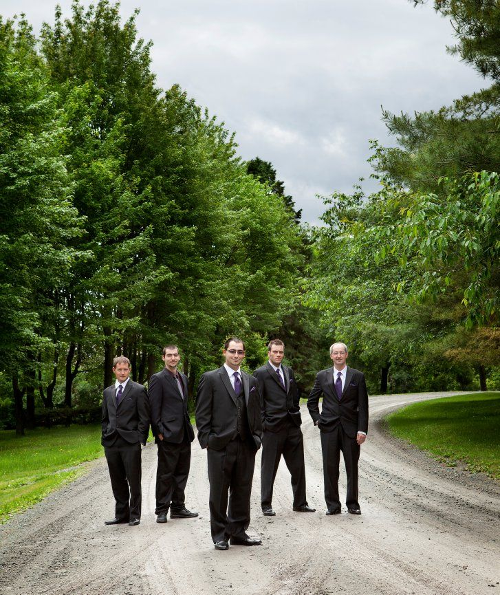mariage, groom and groomsmen under a dramatic sky