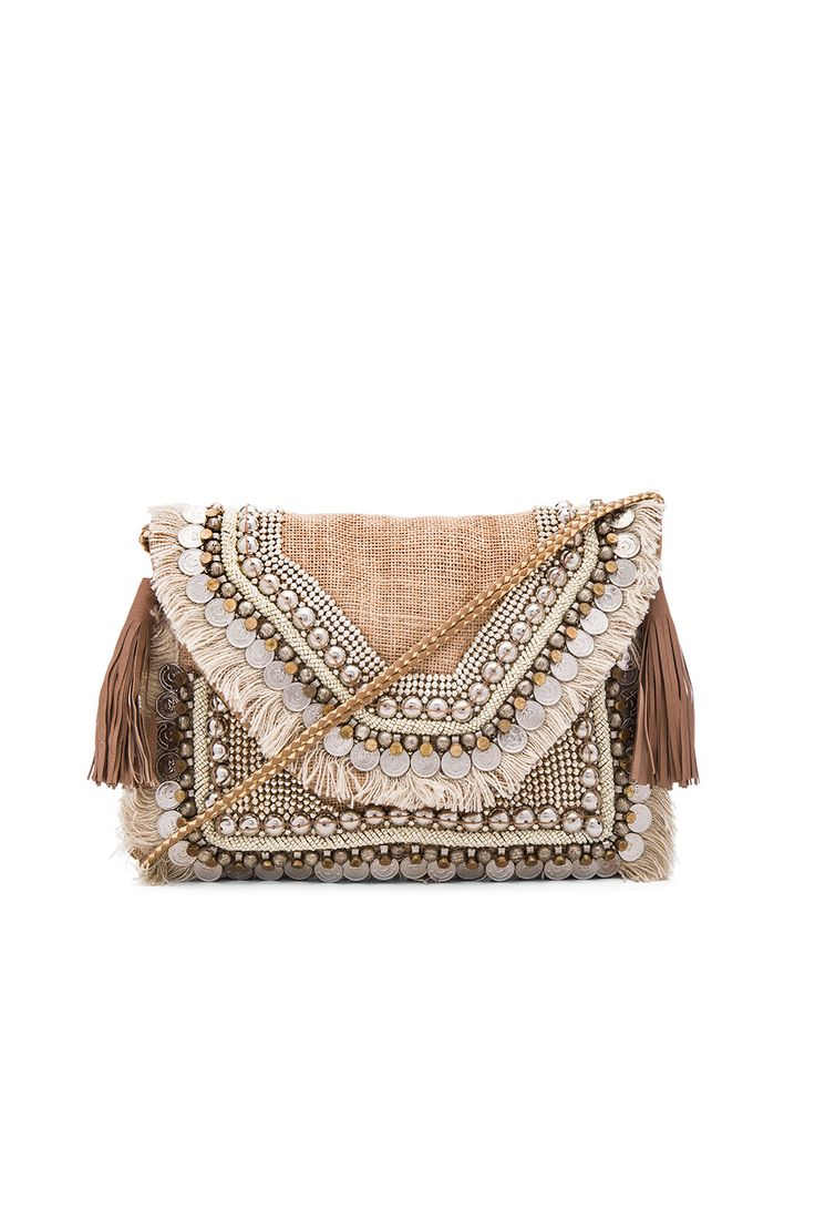 SHASHI: leela clutch in natural.
