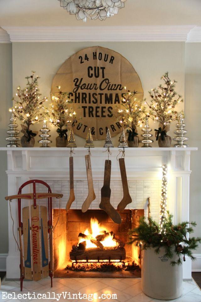 Christmas mantel with antique stocking stretchers kellyelko.com