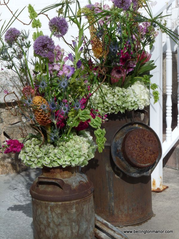 Century old milk cans overflowing with incredible Spring Blossoms. bellingtonmanor.com