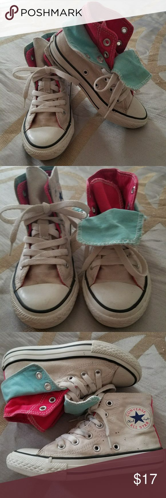 Converse high tops These are in good condition one shoe has some pen marks, these have the fold over look it exposes the mint green and pink color. Very cute! Converse Shoes Sneakers