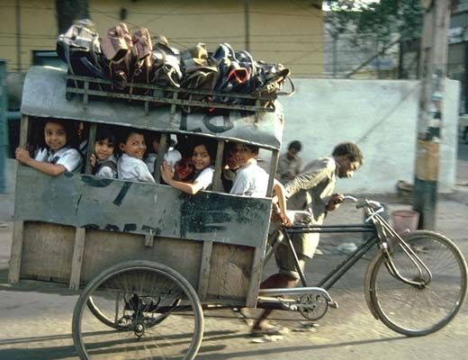 Tricycle school bus. India.
