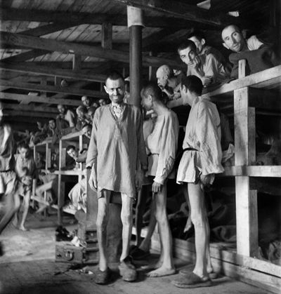 Prisoners at Buchenwald concentration camp. This picture shows living conditions were very bad in concentration camps since everyone was cramped together in rooms or stables. There was no heating or sanitation, and rats and rodents were everywhere, which lead to many epidermics. http://www.jewishvirtuallibrary.org/jsource/Holocaust/auconditions.html
