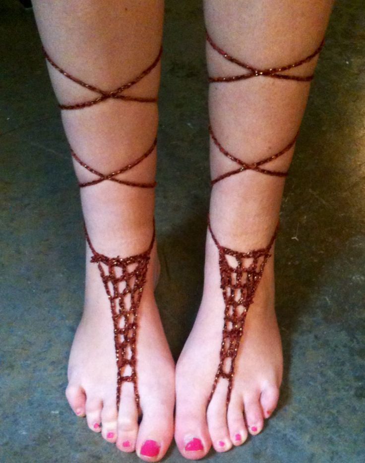 Free Crochet Barefoot Sandal Pattern...  I remember wearing these in CVali when I was a teen, my sister makes jewelry and she has had them in her inventory for years.  they can be made out of anything (ribbons, elastic trim,friendship knots, I've also taken a toe ring added a chain bracelet open, and  going up the leg, add a chain around the ankle to hold it on.  Wear only one or two different.  How about creationg something out of tee remnents.dse