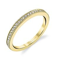 This stunning milgrain detailed wedding band in yellow gold features shimmering round diamonds nestled inside a channel and extending half way down.  Paired with its matching engagement ring in white gold or used as a stackable band with other designs and colored bands, it will create a fashionable look.  The total weight of this appealing band is 0.13 carats.