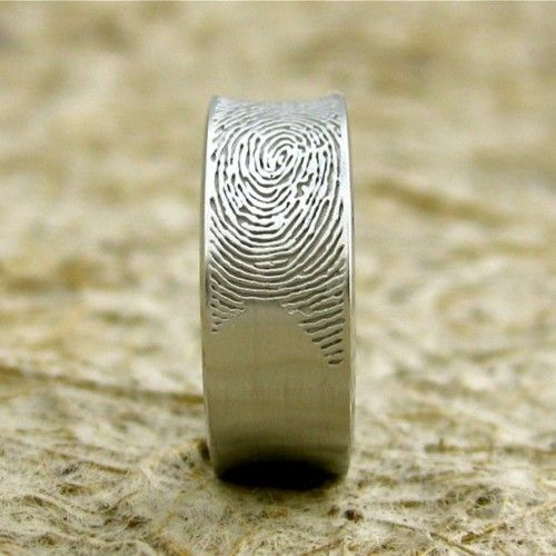Grooms wedding ring, with brides fingerprint. So cute!