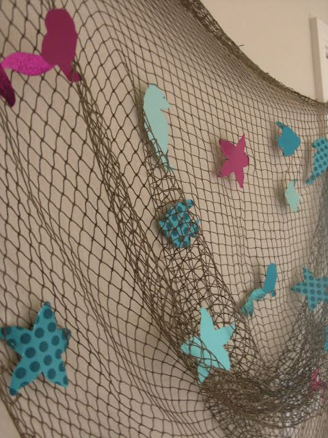 Mermaid Party Decor- could also be an idea to get all the fish/mermaids under the net and all the pirates catching them for a group photo