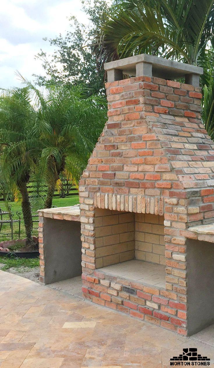 The perfect brick fireplace! #mortonstones #brick #tiles #backyard #home #decor #brickveneer  #exterior #homeimprovement #thinbrick #fireplace #brickfireplace