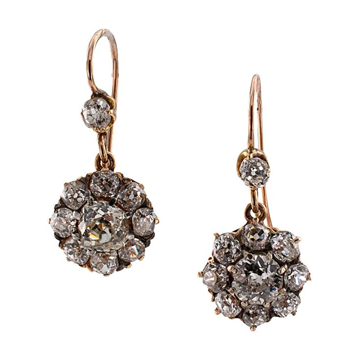 "Edwardian Diamond Gold Drop Earrings. Antique Edwardian Diamond Gold Drop Earrings  These antique earrings, circa 1910, are simple and charming... perfect for everyday wear. Set with twenty old mine-cut diamonds totaling approximately 3.00 carats, 18 karat and 14 karat gold, approximately 1.00"" long overall."