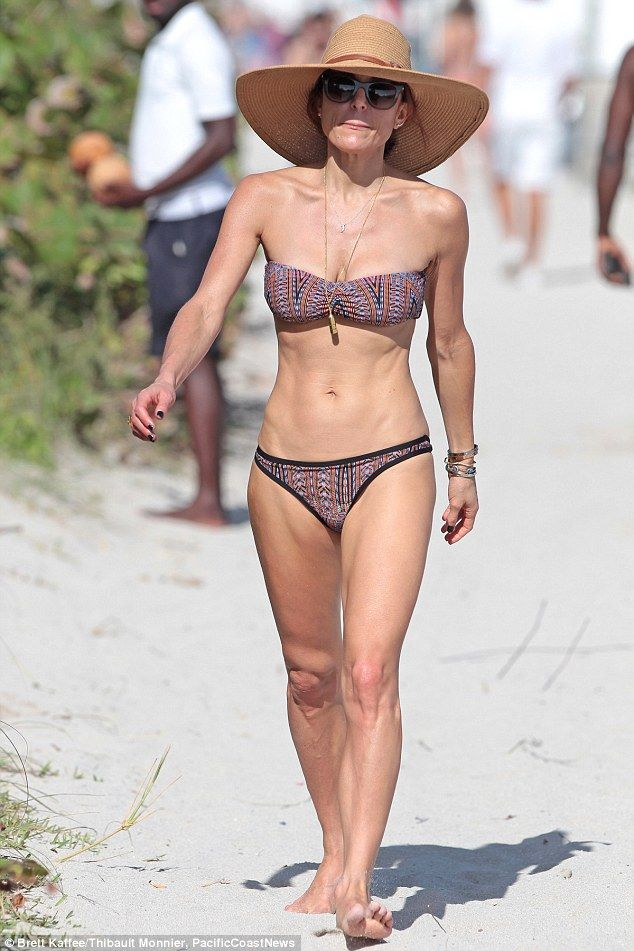 Bare: Bethenny Frankel, 45, looked to be in the best shape of her life as she walked on the beach in Miami on Monday morning