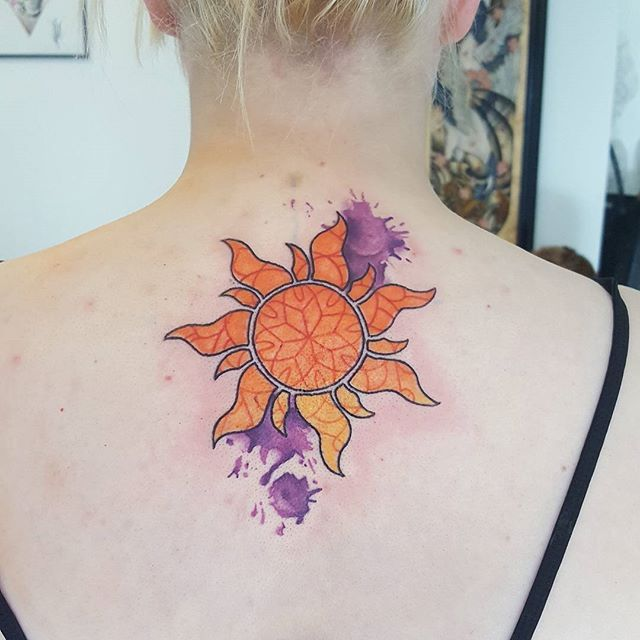 Pin for Later: These 30 Disney Princess Tattoos Are the Fairest of Them All Tangled Watercolor Tattoo