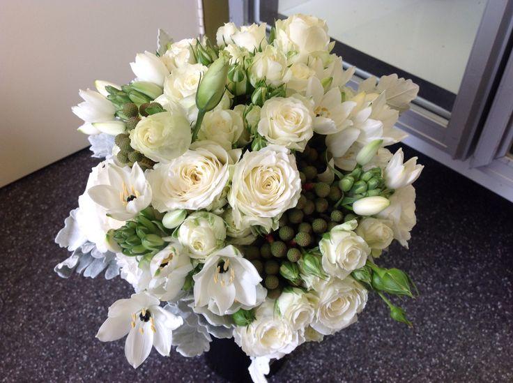Bridesmaids bouquet of David Austen Roses, Berzelia, Lisianthus, Arabs Eyes and Silver Suede foliage