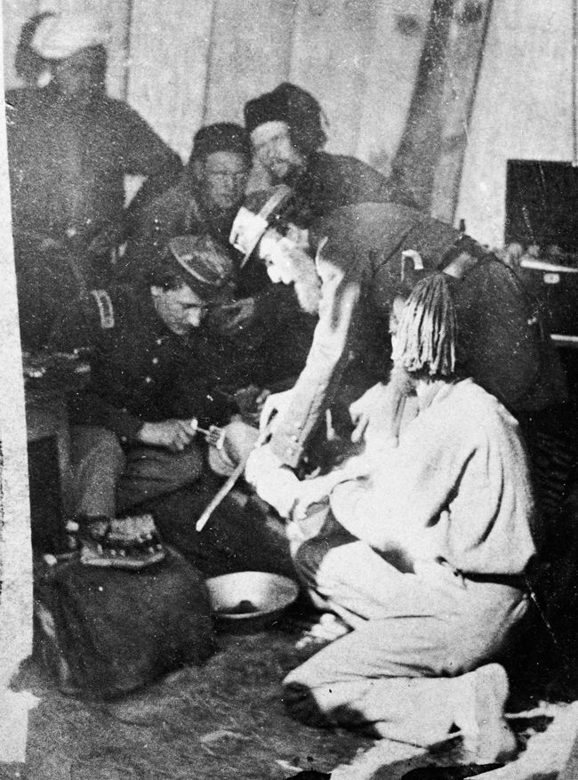 Army doctors perform an amputation in a makeshift hospital during the Civil War. (Photo by Hulton Archive/Getty Images)