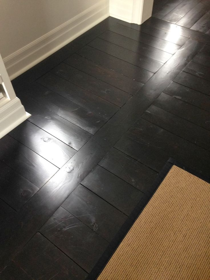 """e 6"""" pine flooring finished in dark Kona stain and top coated with satin varathane"""