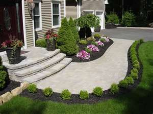 I like the line of bushes going along the stone pathway. Find this Pin and  more on FRONT YARD LANDSCAPING IDEAS ...
