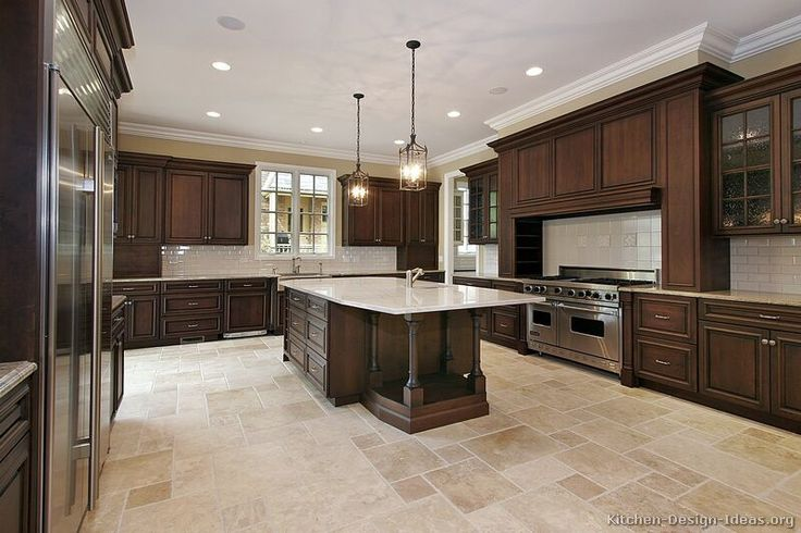 kitchen-cabinets-traditional-dark-wood-walnut-color-dark cabinets with light tile floor