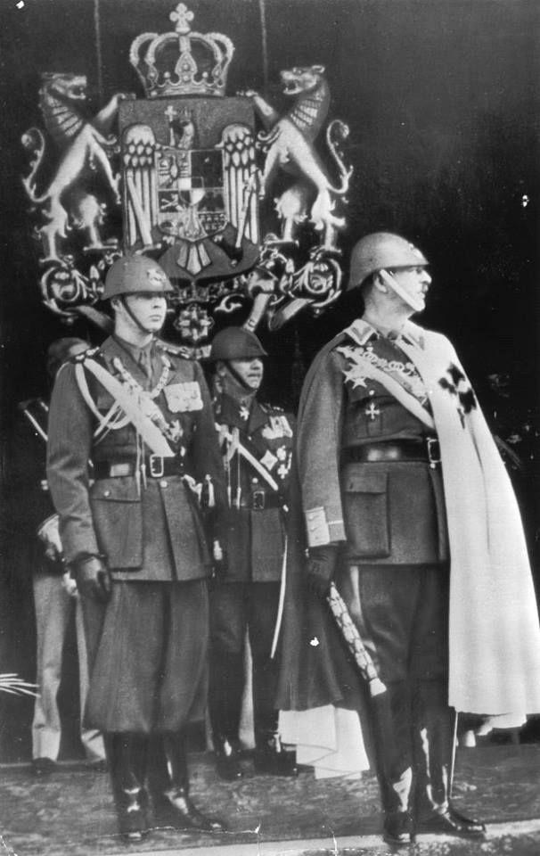 His Majesty King Carol II of Romania (right) with his marshall baton, together with his son Mihai, Great Prince of Alba-Iulia, today King of Romania. In the background, the Royal Coat of Arms of Romania, medium variant. Romanians want their Monarchy back!