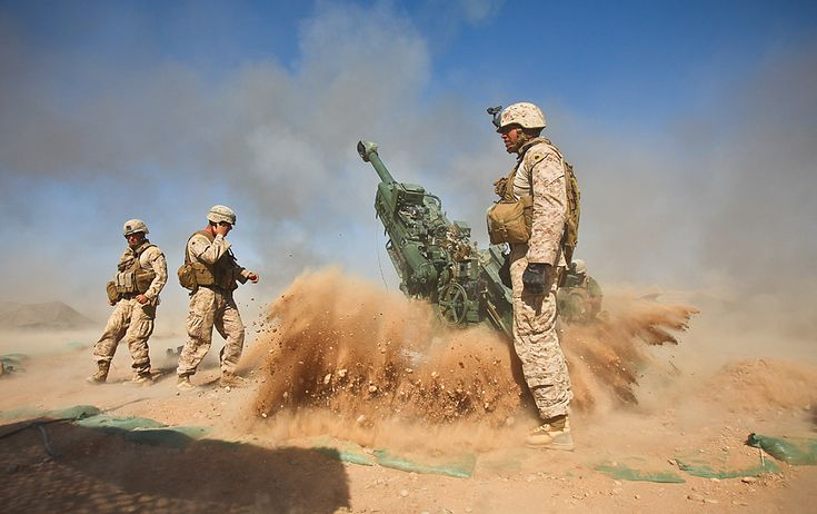 An M777 howitzer kicks rocks and dust into the air after firing during a recent mission.