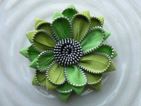 Green Upcycled Vintage Zipper Flower Pin/Brooch/Hair Clip via Etsy. Another local Detroit artist, makes other jewelry and wall art with recycled zippers.