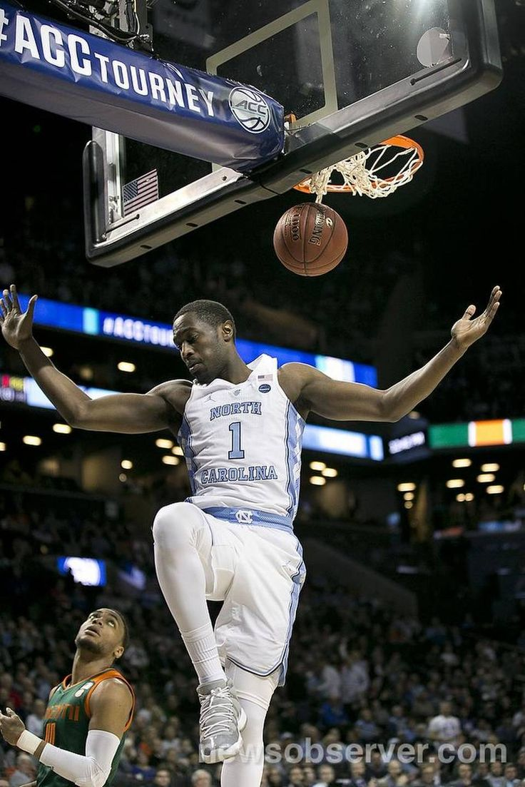 North Carolina's Theo Pinson (1) gets a dunk on a fast break over Miami's Bruce Brown (11) during the first half on Thursday, March 9, 2017 at the Barclays Center in Brooklyn, N.Y.