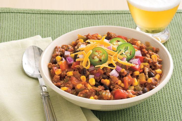 Slow-Cooker Turkey Chili - 101 Best Comfort Food Classics - Southernliving. Recipe: Slow-Cooker Turkey Chili This slow-cooker turkey chili recipe makes it easy for you to get those classic Southern comfort flavors with a minimum hands-on effort. Made from ground lean turkey, chili seasoning, onions, garlic, crisp corn, chopped bell peppers, crushed tomatoes, black beans, and tomato sauce, this Southern chili recipe is perfect for a cold day and packed with major flavor. A can of your…