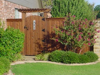 Spanish style wood fences and gates fencing gates wood gates a wood fence without a - Beautiful garden fencing ideas ...
