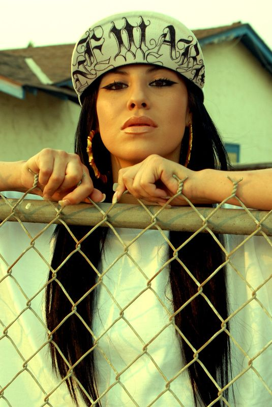 Chola, chicana, latina, door knocker earrings, snapback, make up, barbed wire fence