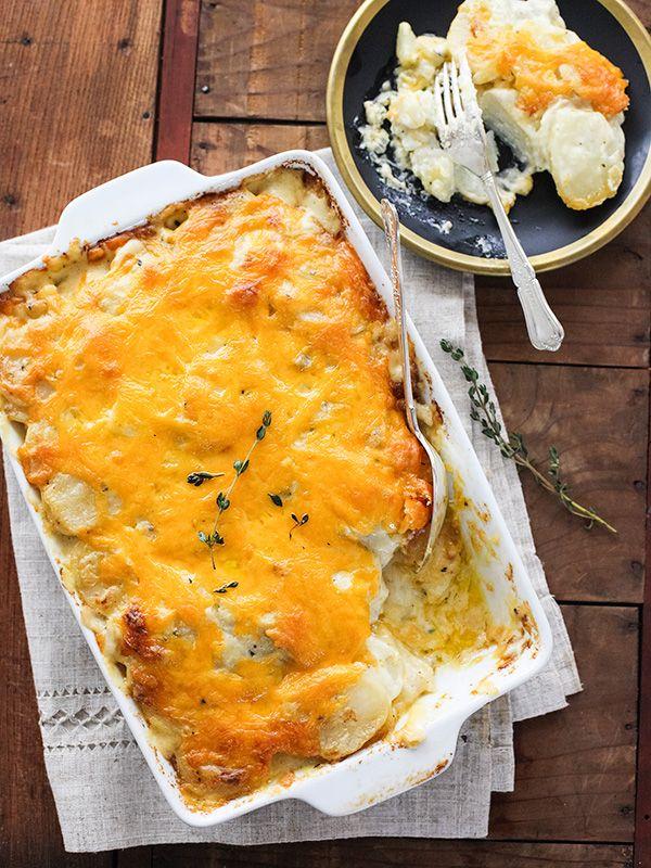 Cheesy Scalloped Potatoes via @Heidi   FoodieCrush -- love me some cheesy potatoes