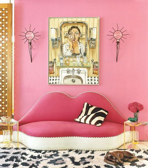12 (Adult) Ways to Decorate With the Color Pink - pink walls,  statement lip-shaped couch, a zebra print accent pillow and leopard rug (all in the same room)!
