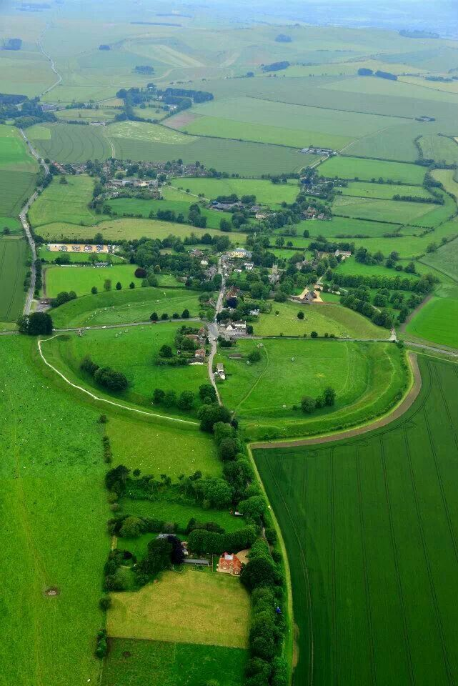 Avebury stone circle, in Wiltshire, southwest England. It's a Neolithic henge monument containing three stone circles, constructed around 2600 BC (Been there, memories of 1985)
