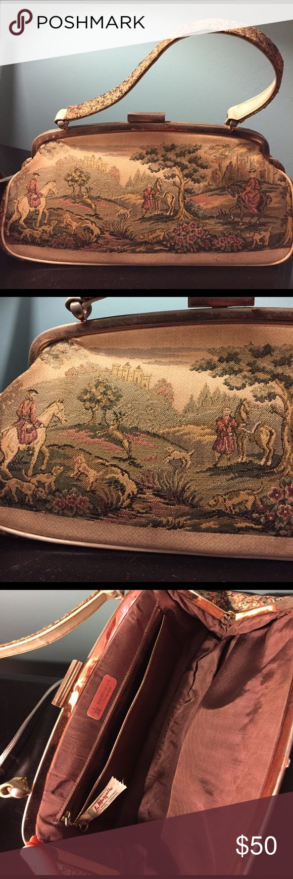 """💝 Vintage Tapestry Handbag This vintage tapestry bag is very charming. The scene in the bag is of horsemen with dogs, in the background is a castle. The bag has a snap closure which works perfectly with some wear on handle. Inside is a brown material in great condition, with a pocket as well as an additional zip pocket. Tag inside reads """"handlers by La Marquis made of the finest Italian tapestry.""""  Bottom is all 🌺 flowers. Measures 12 x 6 x 3.5 inches. Hemsley's Bags Mini Bags"""