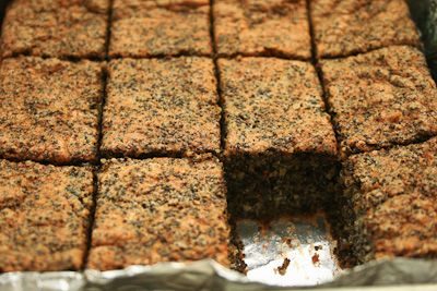 Flourless Poppy Seed Cake- 160 grams raw almonds, 60 grams butter, at room temperature,125 grams light brown sugar,160 grams poppy seeds,finely grated zest from one organic lemon. 4 eggs, separated, pinch of salt