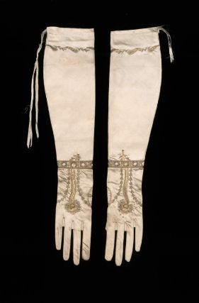 Pair of women's gloves, silk satin embroidered with gold metallic yarns and spangles. French, early 19th century - in the Museum of Fine Arts Boston costume collection. (Note the peacock feather design in the embroidery.)