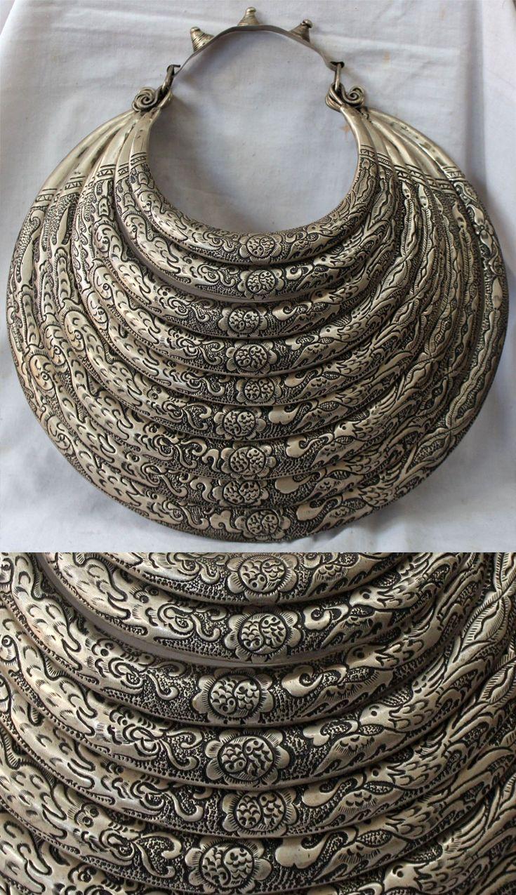China | Big Gui Zhou, clan Miao | 9 hoop; dragon and phoenix | 355$ | Source; www.ebay.com/...