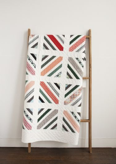 "Beautiful colors and stunning whites play well together in this new ""Between the Lines"" quilt from Denyse Schmidt."