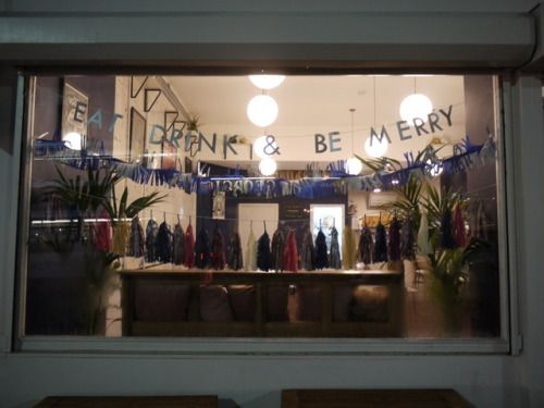 EAT DRINK & BE MERRY ~ words to live by Main window display for Cafe Strange Brew