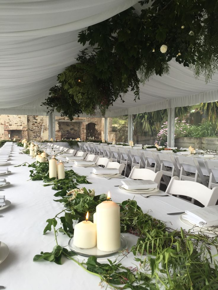 Contemporary and classic styling with hanging foliage and pillar candles at Bushbank, Kiama