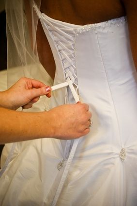 How to Put a Corset Back in a Wedding Dress - This could be useful for any formal dress.