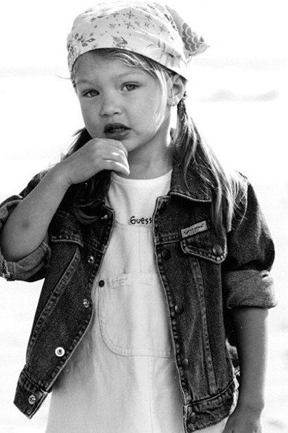 A two-year-old Gigi poses in her first campaign for Baby GUESS with adorable pigtails and a handkerchief bandana that makes us nostalgic for the '90s. Via @teenvogue #GUESSKids
